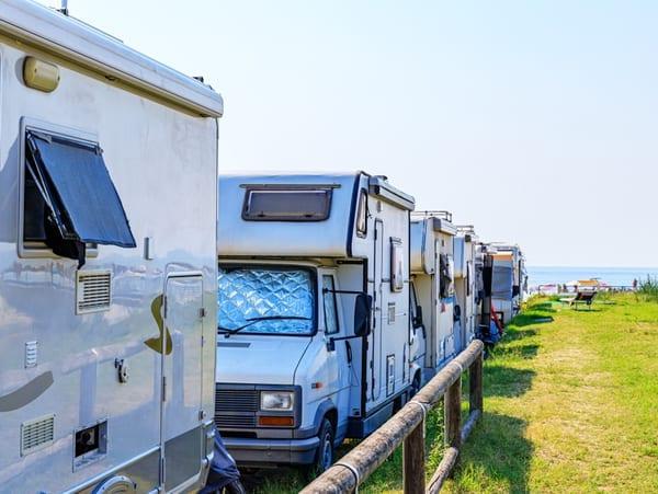 caravans parked along a beach side caravan park